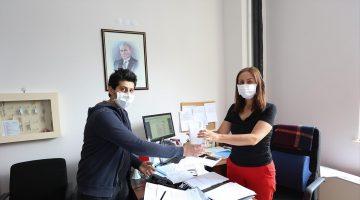 PAÜ, Yeni Normal Döneme de Dezenfektan ve Maske Dağıtımı ile Başladı